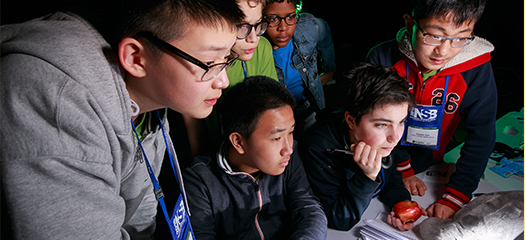several students grouped around a computer screen