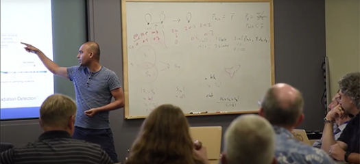 a computer scientist presents to a room full of people