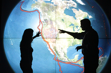 Scientists in front of an earthquake visualization