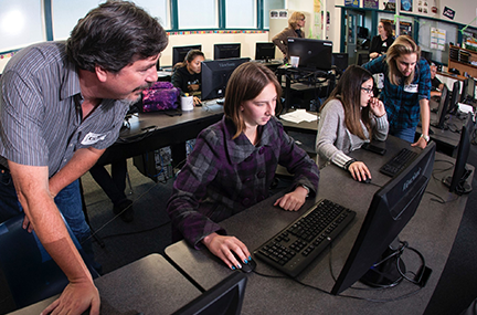Students learn at computer terminals
