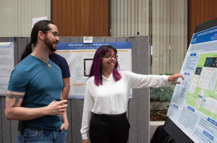 Ian Lee mentors his summer student at a poster session