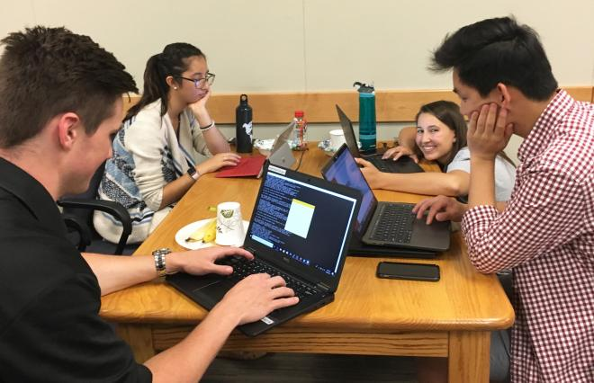 students work as a team at a hackathon